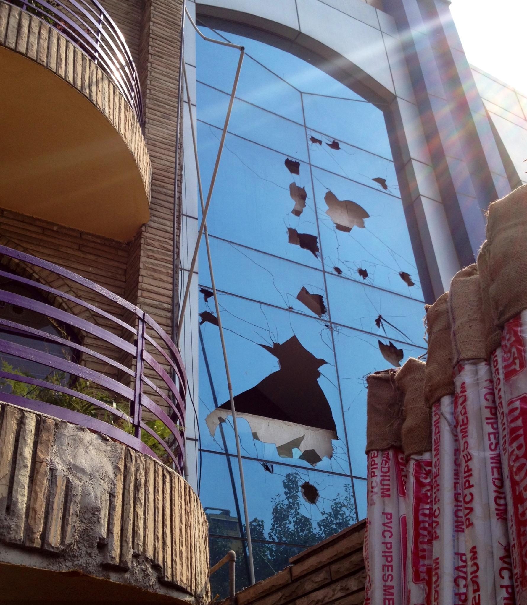 Smashed windows in Okhla Phase 1, New Delhi, India photo